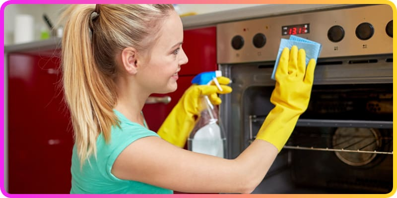 Scrubbing The Oven In Kitchen